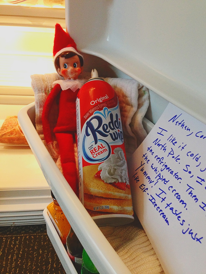 Elf is in fridge eating imitation north pole ice cream (whipped cream). Elf on the Shelf ideas by Carey Pace